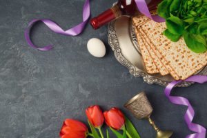 Pessach @ Combat & Counterterrorism School Berlin. Passover holiday concept seder plate matzoh and tulip flowers.